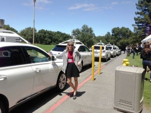 Kara Kockelman next to car (photo)