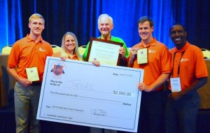UT Austin team is handed a $2,000 check for their ITE Traffic Bowl win (photo with 5 people)