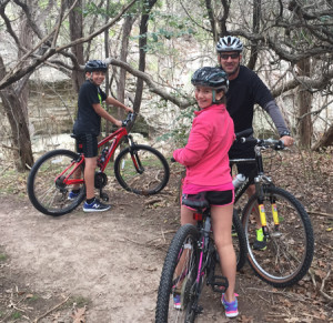 Tom Fowler with family biking