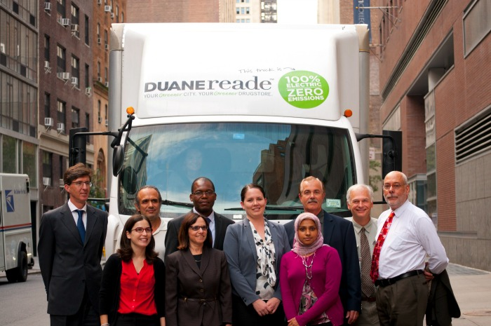 "Photo of Alison and 9 others in front of DUANEreade truck that says ""this truck is 100 percent Electric Zero emissions"""