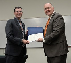 Jeff receiving Excellence in Research Award for a Junior Faculty