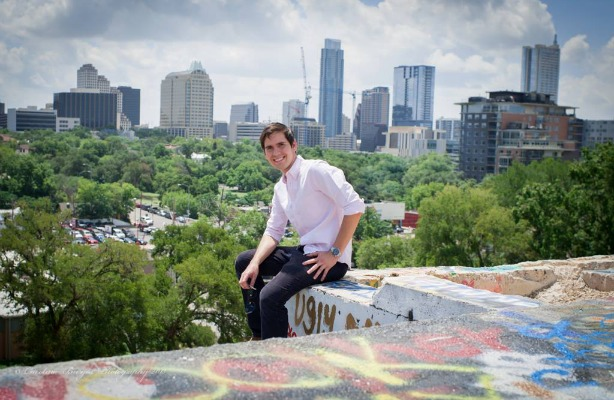 Juan Pablo Gevaudan at graffiti structure, City of Austin skyline