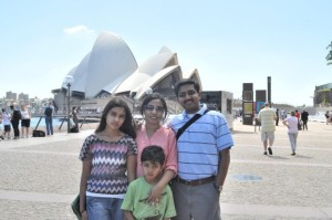 Family photo in front of sydney Opera House in Australia